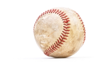 Dirty baseball isolated on white, close-up